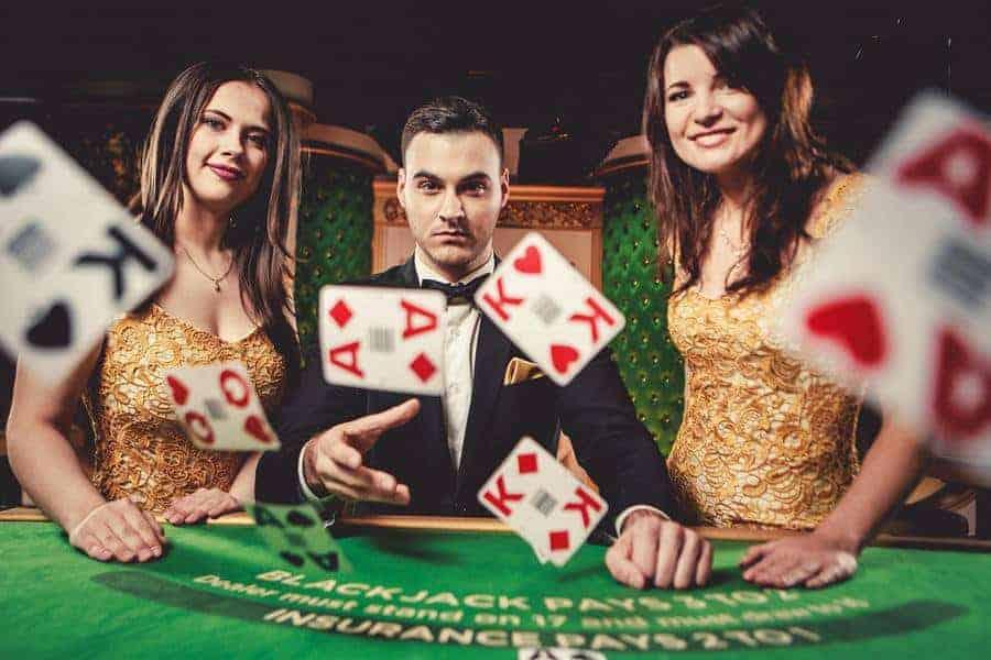 Three blackjack dealers throwing cards