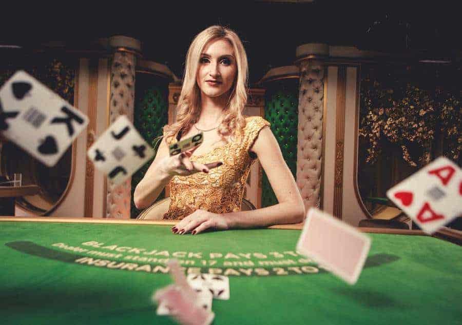 Brunette blackjack dealer throwing cards
