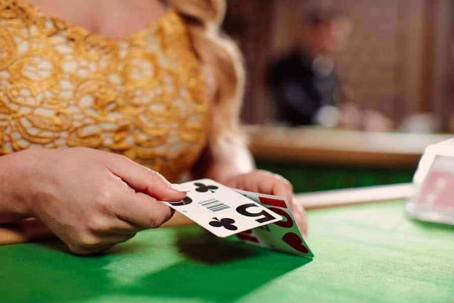 Hand folding blackjack cards