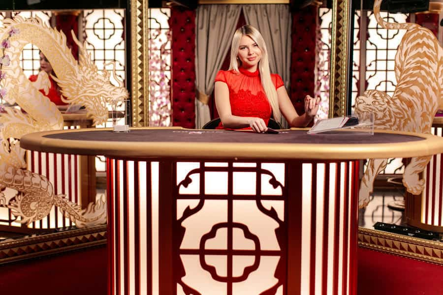 Beautiful casino dealer sitting at table