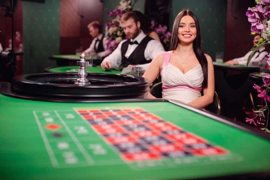 Brunette dealer at the end of roulette table