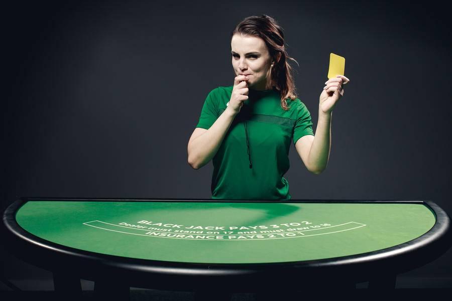 Woman standing at live blackjack table